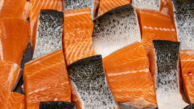 display of fresh salmon fillets - saltwater fish stock videos & royalty-free footage