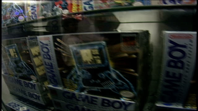 display of game boy packages and games in glass case - handheld video game stock videos & royalty-free footage