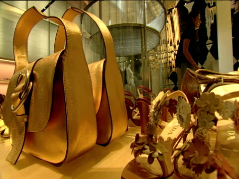 display of handbags and shoes in designer clothes boutique with glass elevator new york - ブランド名点の映像素材/bロール