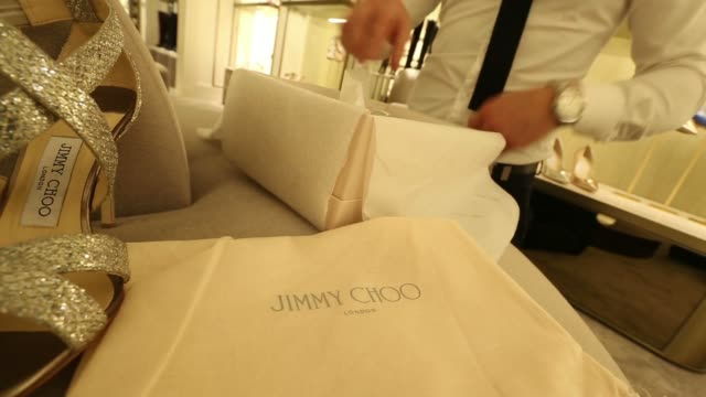 a display of jimmy choo riane clutch bags are displayed for sale inside the company's luxury flagship store operated by jimmy choo ltd a unit of jab... - expense stock videos & royalty-free footage