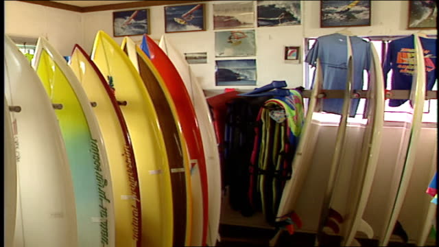 display of surfboards in store malibu california - water sports equipment stock videos and b-roll footage