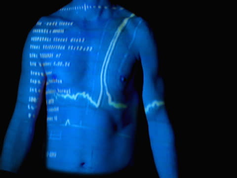 ecg displayed on man's bare torso - torso stock videos & royalty-free footage