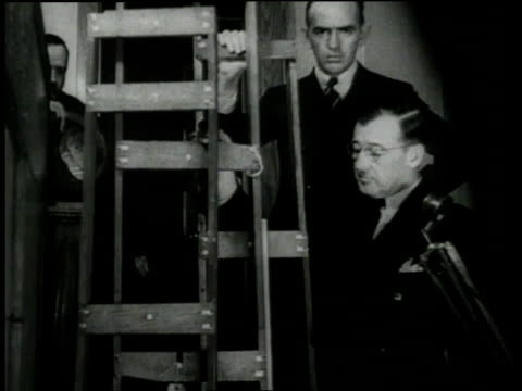 vídeos de stock, filmes e b-roll de displaying evidence in the trial of accused killer of charles lindbergh's infant son / new jersey, united states - 1935