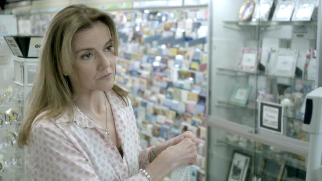 CU, Displeased woman in pharmacy, Scotch Plains, New Jersey, USA