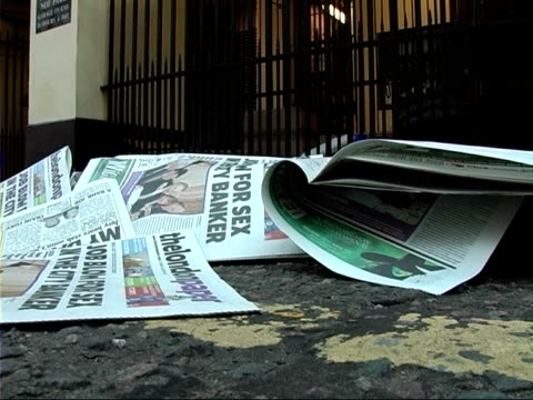 disposal of london's free newspapers: newspaper recycling bins; various of free newspapers, 'the london paper' littered at side of road / newspaper... - sidewalk gutter stock videos & royalty-free footage