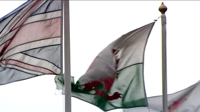 ofqual defends decision on raising grade boundaries lib wales cardiff ext union jack and welsh flag flying gv welsh assembly building portrait of... - gcse stock-videos und b-roll-filmmaterial