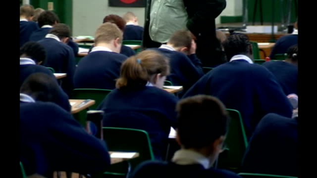 disputed gcse english exam results to stand; anonymous shot of schoolchildren sitting exam - general certificate of secondary education stock videos & royalty-free footage