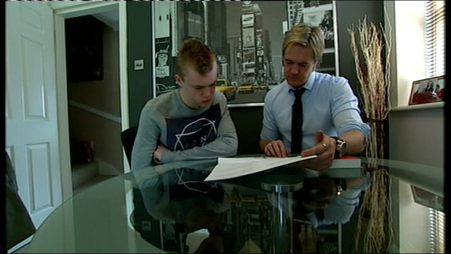 disputed gcse english exam results to stand england int sheridan sidlow setup looking through documents at table with his father mark sidlow sheridan... - 一般教育証明試験点の映像素材/bロール