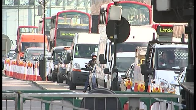 disruption continues following holborn fire england london ext taxis and double decker buses in traffic jam people crossing road past traffic jam... - moving after stock videos & royalty-free footage