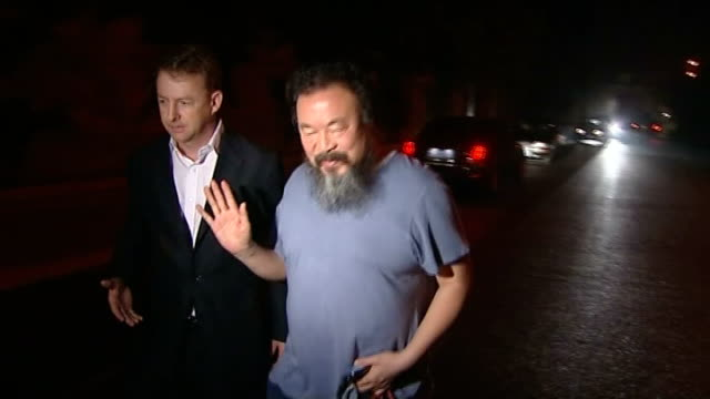 Dissident artist Ai WeiWei released from jail by Chinese government CHINA Ai WeiWei out of car as greets ITN reporter and camera operator then speaks...