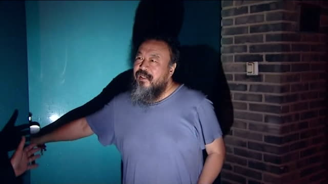 Dissident artist Ai WeiWei released from jail by Chinese government CHINA Beijing Weiwei at his front door speaking to reporters and into house