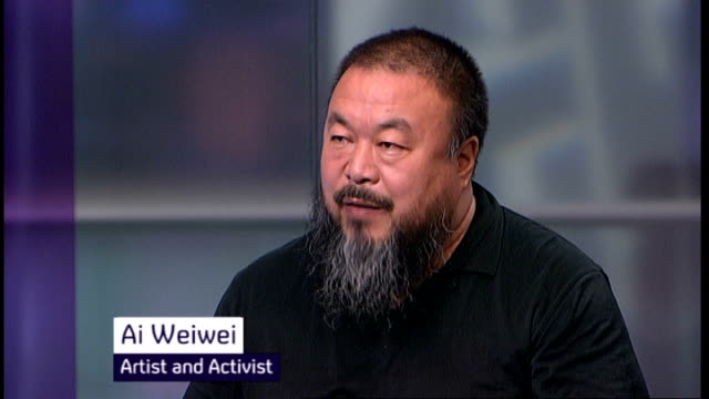 Dissident artist Ai WeiWei released from jail by Chinese government T08101038 London Ai Wewei STUDIO interview on Channel 4 News with Alex Thomson...