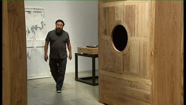 Dissident artist Ai WeiWei released from jail by Chinese government TX Various views of Ai Weiwei in his studio