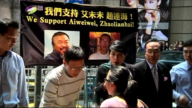 Dissident artist Ai WeiWei released from jail by Chinese government LOCATION Supporters of Ai WeiWei on street stall Close shot of supporters'...
