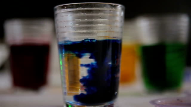 dissolving blue ink in the water,abstract - mixing stock videos & royalty-free footage