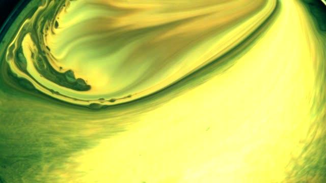 dissolving green liquids. slow motion - splash crown stock videos and b-roll footage