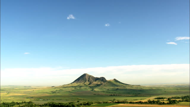 distant approach to bear butte  - aerial view - south dakota,  meade county,  united states - butte rocky outcrop stock videos & royalty-free footage