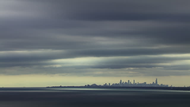 distant chicago skyline under cloudy sky - distant stock videos & royalty-free footage
