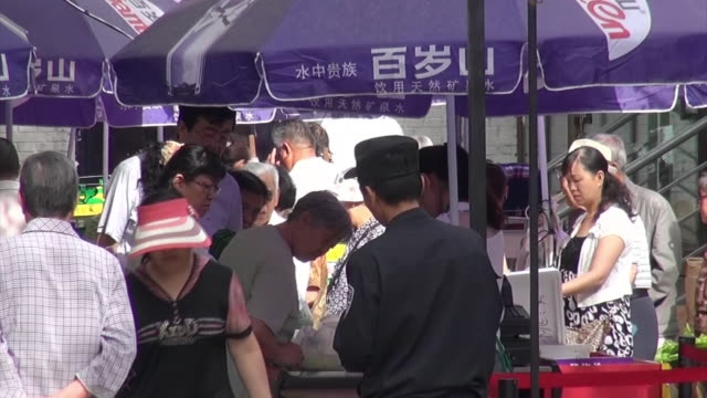 distant shot of an outdoor market newly opened near the site of explosion occurred in 2014 22nd may security staffs standing at the entrance of the... - ショットを決める点の映像素材/bロール