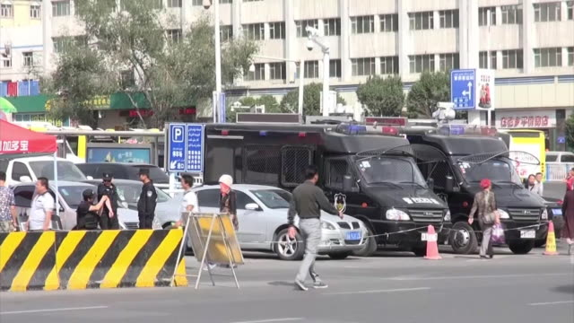 distant view of surrounding area of urumqi station where an explosion ocurred in 2014 april security system around the station - xinjiang province stock videos & royalty-free footage