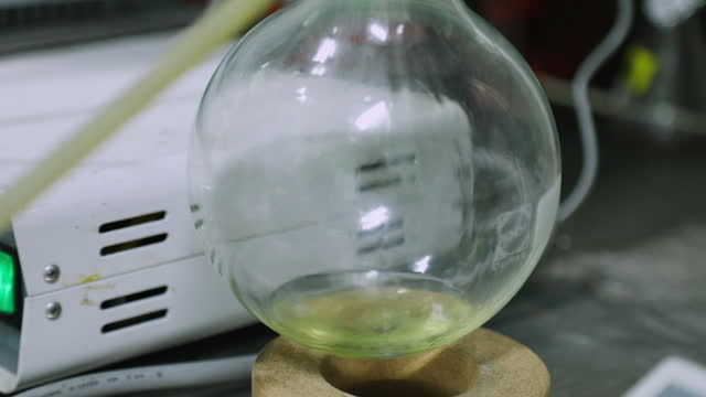 distilled liquid falling in flask - biochemistry stock videos & royalty-free footage