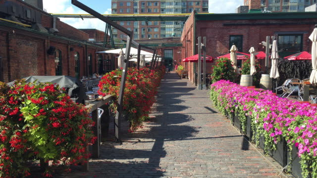 distillery district: restaurants and patios in the tourist attraction-toronto,canada - distillery stock videos and b-roll footage