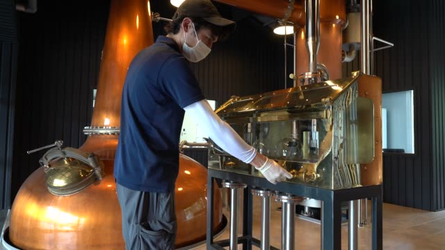 a distillery operator looks in the spirit safe in the still house during the production process of 'new pot 70' a whiskey with 70 percent alcohol at... - distillery still stock videos & royalty-free footage