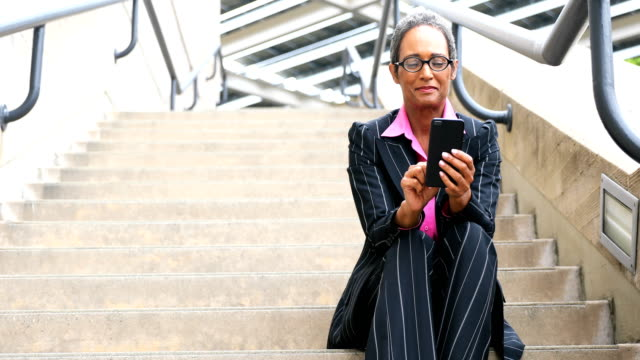 Distinguished Senior African American Businesswoman Texting