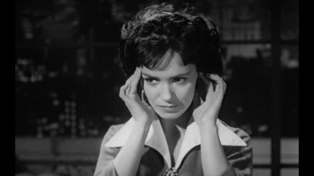 1959 distracted by a headache, business owner (susan cabot) calls secretary to talk about missing letter - head in hands stock videos and b-roll footage