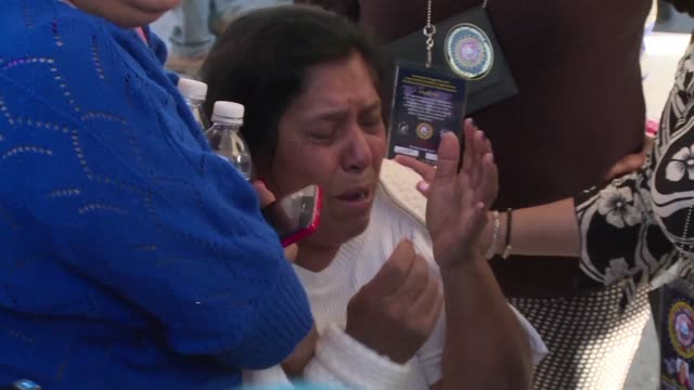 distraught families gather outside the topo chico jail in monterrey northern mexico as authorities start releasing the names of the 49 inmates who... - northern mexico stock videos & royalty-free footage
