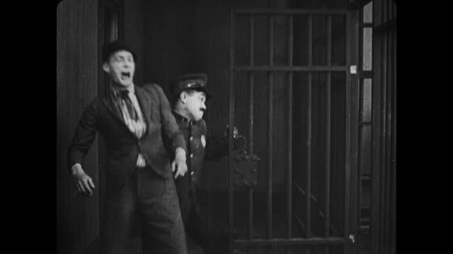 1917 distraught man arrested and thrown around by police in jail tries not to panic - 1917 stock videos & royalty-free footage