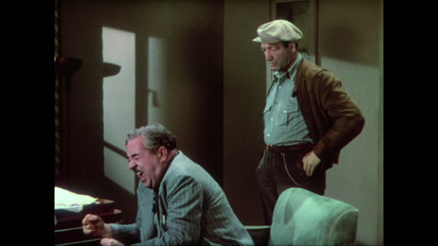 1937 Distraught man (Walter Connolly) asks sniffing man (Maxie Rosenbloom) to be quiet