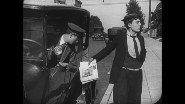 Distraught Buster Keaton hides wanted poster from woman before accompanying her to a hotel