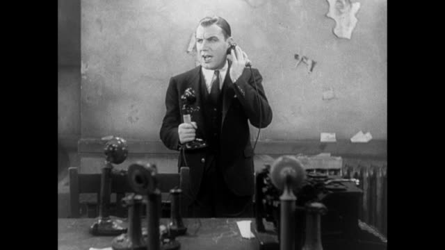1931 distraught reporter (pat o'brien) ignores sexist remarks of editor (adolph menjou) as he looks for his mother in law - sex discrimination stock videos & royalty-free footage