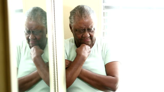 distraught senior african-america woman - hand on chin stock videos & royalty-free footage