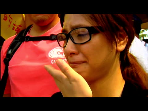 distraught taiwanese woman comments on missing family members following typhoon morakot taiwan 12 august 2009 - taiwan stock videos & royalty-free footage