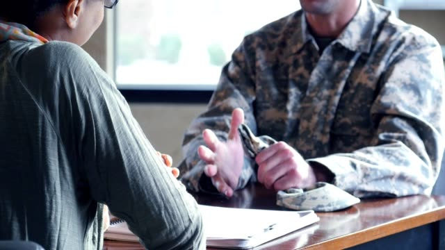 distressed military veteran talks with psychiatrist - armed forces stock videos & royalty-free footage
