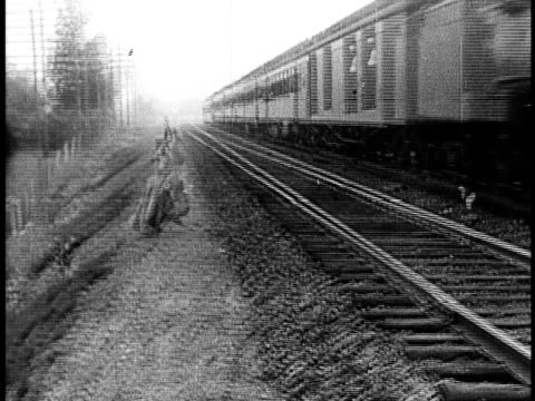 1910 b&w distressed young woman running along moving train with arms raised/ usa - anno 1910 video stock e b–roll