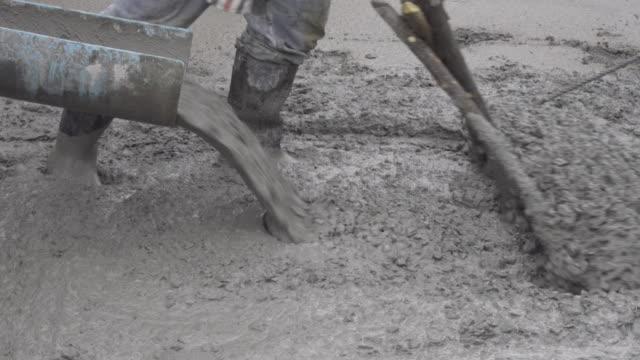 verteilung von beton 4k. - beton stock-videos und b-roll-filmmaterial