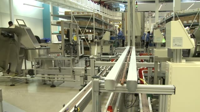 distribution center pill bottles going down factory assembly line on december 04, 2013 in mount prospect, illinois - cvsケアマーク点の映像素材/bロール