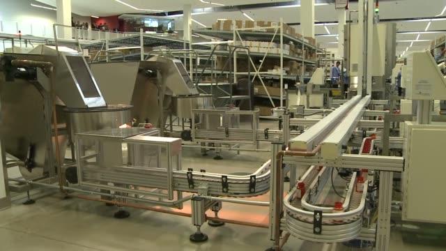cvs distribution center pill bottles going down factory assembly line on december 04 2013 in mount prospect illinois - cvs caremark stock videos & royalty-free footage
