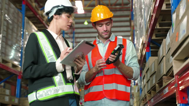 distribution warehouse manager training new worker for work - quality control stock videos & royalty-free footage