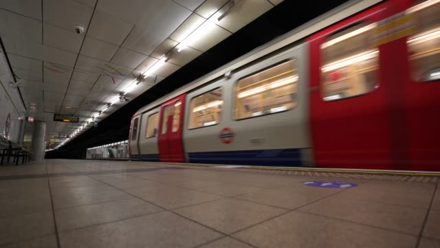district line train pulls into an empty embankment station platform as lockdown restrictions are eased after 7 weeks on may 13 2020 in london england... - pulling stock videos & royalty-free footage
