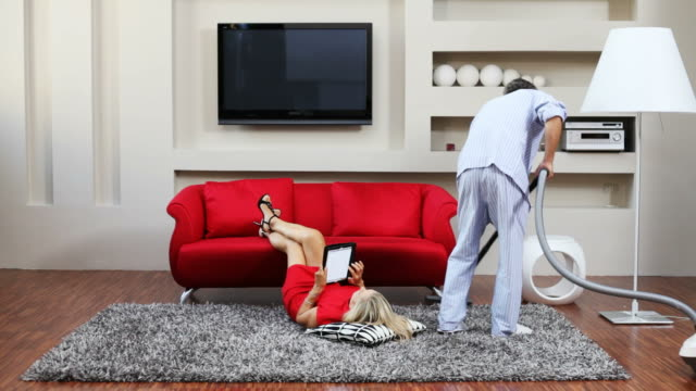 disturbing her husband's wife, with the housework - housework stock videos and b-roll footage