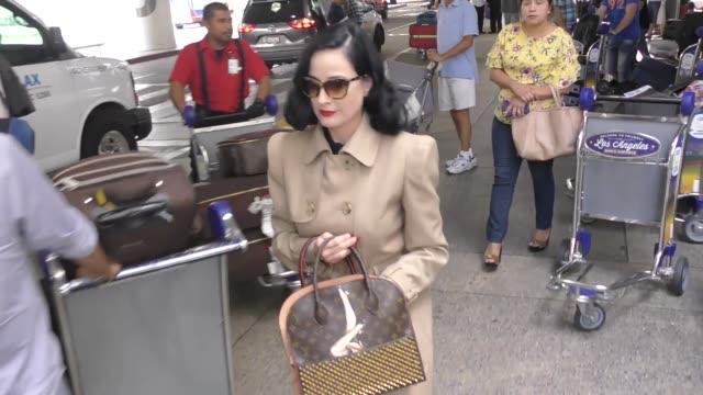 vídeos de stock, filmes e b-roll de dita von teese arriving at lax airport in los angeles in celebrity sightings in los angeles - dita von teese