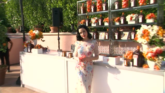 dita von teese at cointreau and dita von teese launch cointreau poolside soirees in celebration of the beverly hills hotel's 100th anniversary in... - beverly hills hotel stock videos and b-roll footage