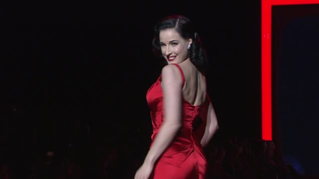 vídeos de stock, filmes e b-roll de dita von teese at the the heart truth's red dress collection runway fall 2011 mbfw at new york ny - dita von teese