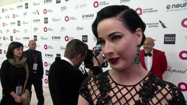 vídeos de stock, filmes e b-roll de interview dita von teese on being at the event and on elton john at the 23rd annual elton john aids foundation academy awards viewing party sponsored... - festa do oscar