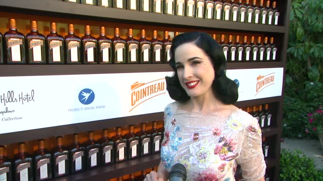 dita von teese on her new show, what she is wearing and what she looking forward to tonight at cointreau and dita von teese launch cointreau poolside... - beverly hills hotel stock videos & royalty-free footage