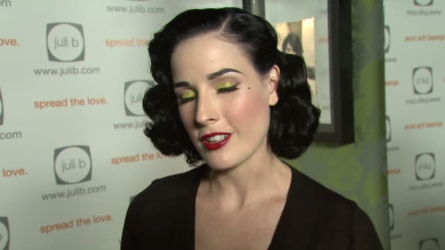vídeos de stock, filmes e b-roll de dita von teese on performing in la vs other parts of the world at the celebration for 'wicked' hosted by julif com with a special performance by dita... - dita von teese